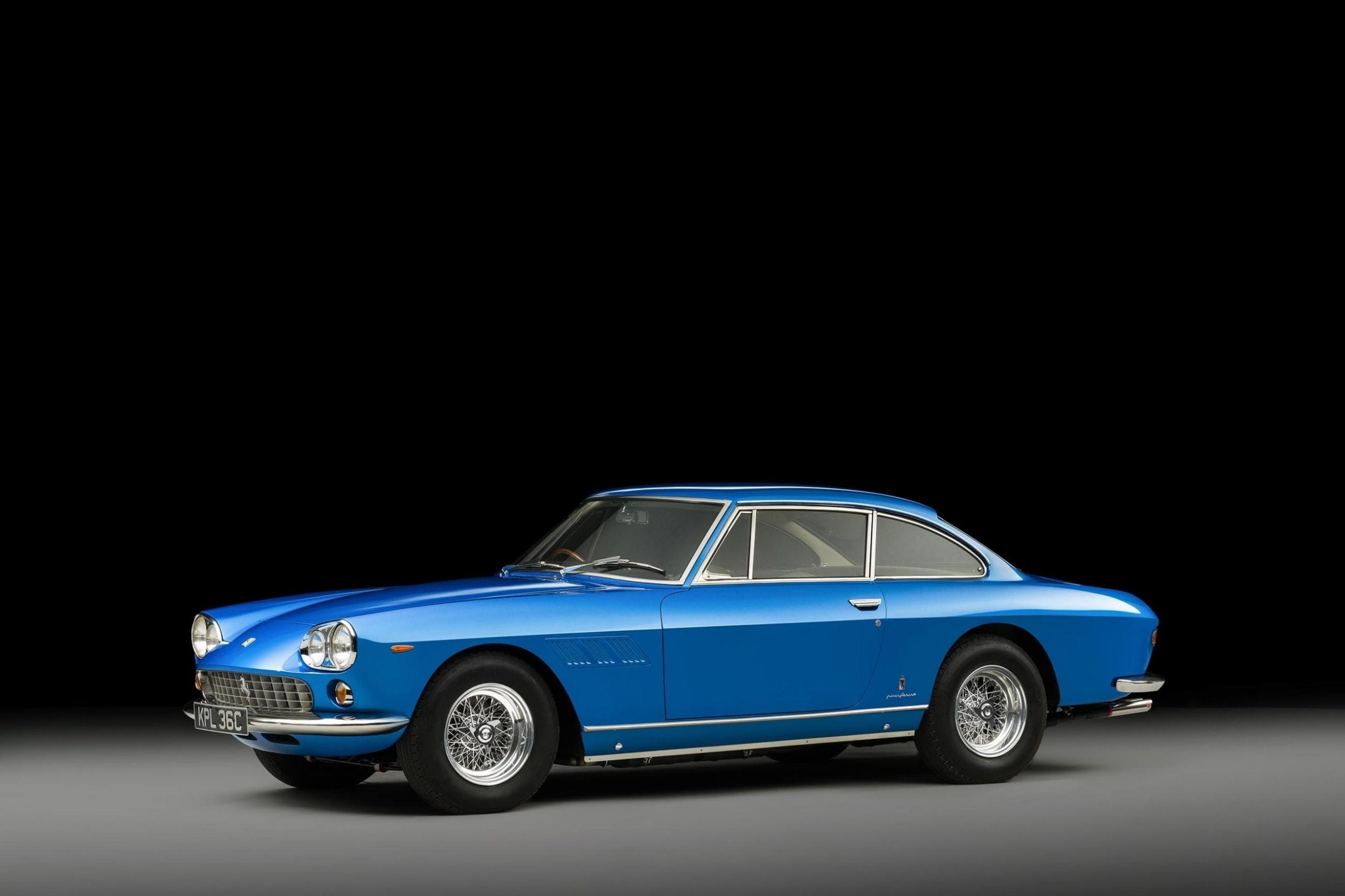 side view of 1965 burt blue ferrari 330 gt